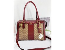 COACH Charlie Carryall Hand Bags