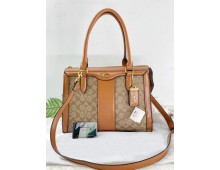 COACH Charlie Carryall Hand Bags
